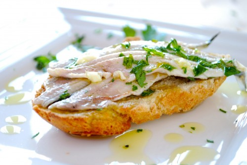 Spanish tapa of anchovies marinated