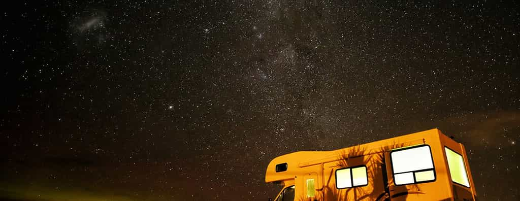 Campervan at night under the stars