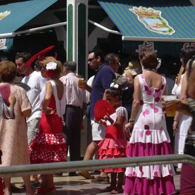 Bars and people in Malaga Day Fair