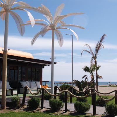 Beach bar and fake white palms