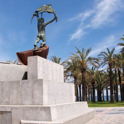 Beach El Remo and monument